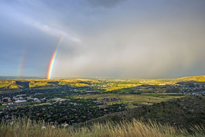 a rainbow sets in over the horizon of Golden, CO | Golden HOA Management
